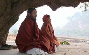 Meditating practitioners in a cave
